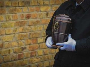 Funeral Director Giving Ashes to Algordanza for Cremation Diamond
